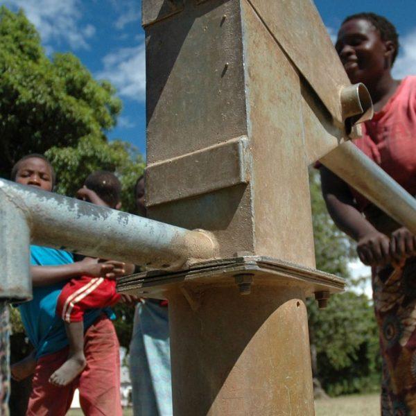 People at water pump